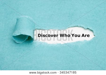Text Discover Who You Are Appearing Behind Torn Blue Paper. Finding Yourself Or Personal Development