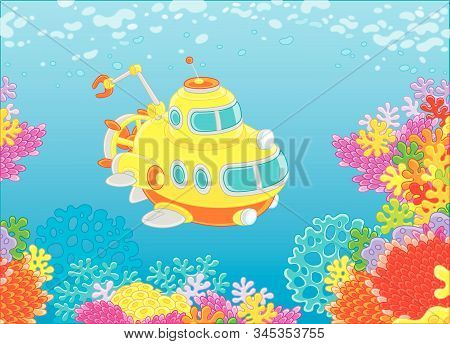 Exploratory Deep-sea Bathyscaphe With A Manipulator Swimming Over Colorful Coral Reef In Blue Water