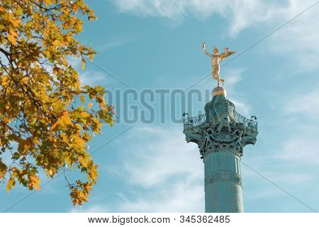 Paris, France - September 18, 2019: July Column topped with the gilded statue of Spirit of Freedom by Auguste Dumont.The monumental column was erected in 1835-1840 to commemorate Revolution of 1830