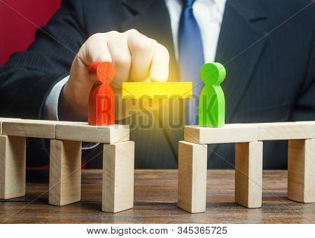 A Man Mediates In The Negotiation Process. Compromise And Dispute Resolution. Build Bridges Improve