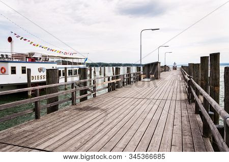 Inning Am Ammersee, Germany - July 6 2019: Paddle Steamer Diessen Floating By Pier On The Lake Ammer