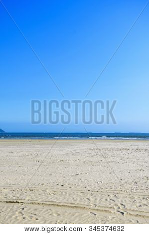 Brazilian Paulista Beach With A Huge Band Of Waterfront Sand On Beautiful Day. Photo At Itarare Beac