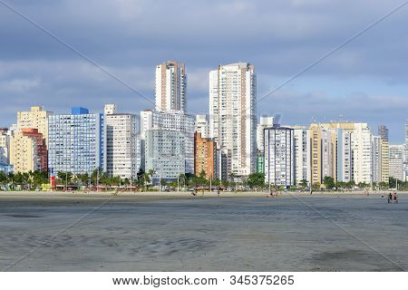 Sao Vicente - Sp, Brazil - November 21, 2019: View Of The Sand And The Seafront Buildings Of Praia D