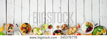 Healthy Breakfast Food Banner With Bottom Border. Table Scene With Fruit, Yogurt, Smoothie Bowl, Nut