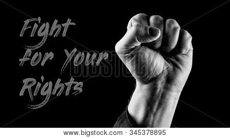 Fight For Your Rights, Fist Up. Concept Of Power. Man With Fist Up Wearing Long Sleeve Jacket. Black