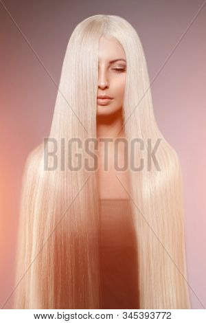 Model blonde with long healthy shiny hair. Woman wearing hair