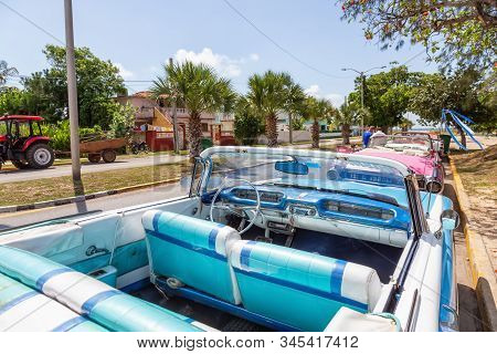 Varadero, Cuba - May 8, 2019: Classic Old Taxi Car In The Street During A Vibrant And Bright Sunny D