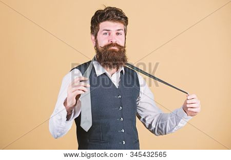 Art Of Manliness. Man Bearded Hipster Try To Make Knot. Different Ways Of Tying Necktie Knots. How T