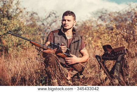 Man With Rifle Hunting Equipment Nature Background. Prepare For Hunting. What You Should Have While