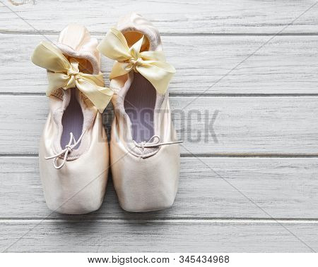 Pointe Ballet Shoes On White Wooden Background