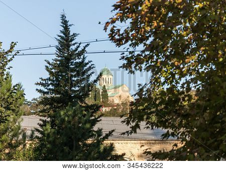 Kutaisi, Georgia, October 13, 2019 : The St. George Church Is Visible In The Gap Between The Trees I