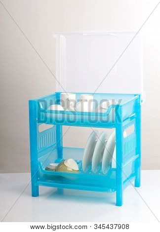 Plastic Shelf For Keeping Dishs And Accessory On White Table