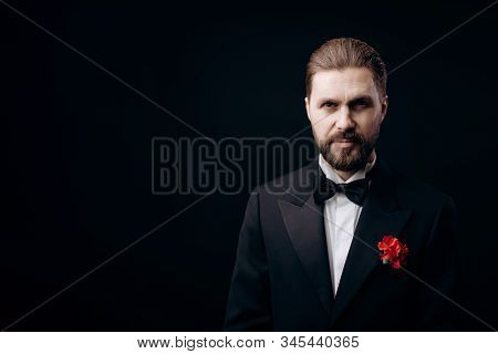 Handsome Brunet in Black Tie With a Carnation Boutonniere poster