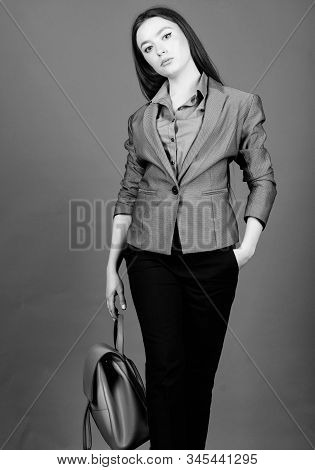 Stylish Woman In Jacket With Leather Backpack. Girl Student In Formal Clothes. Student Life. Smart B
