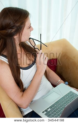 Woman Thinking While On Her Laptop.
