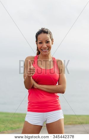 Sporty motivated fit confident woman crossing arms and looking at camera. Female fitness lifestyle motivation concept. poster