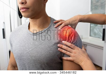 Athlete Suffers From Shoulder Pain. Physiotherapist Helps Treat Shoulder Injury. Shoulder Pain