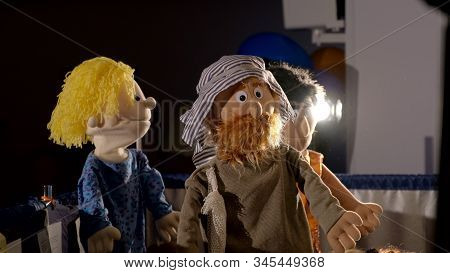 Three Puppet Dolls Hiding Under The Scenes During The Performance In Puppet Theater. Two Puppet Men