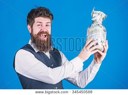 Obtaining Funding For His Startup Company. Happy Businessman Holding Glass Jar With Money Cash To Co