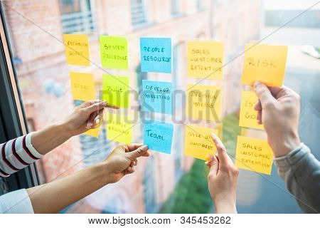 Business People Meeting At Office And Use Post It Notes To Share Idea. Brainstorming Concept. Sticky