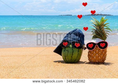 Merry Tropical Fruit With Hearts In The Eyes On The Sea Beach. Honeymoon And Happy Valentines Day.