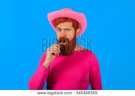 Portrait Of Cowboy With Lollipop. Man Wearing Cowboy Hat. American Bandit. Western Man With Hat. Pin
