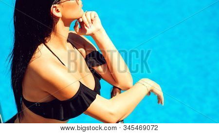Seductive Woman In A Black Fashion Swimsuit On The Sea. Summer Fashion, Travel And Vacation. Best Of
