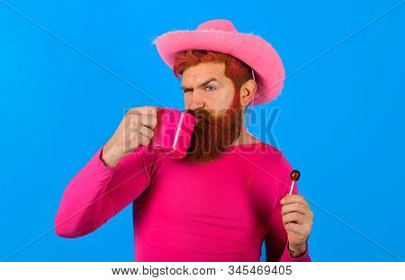 Cowboy With Cup. American West. Western Man With Hat. Pink Velvet Cowboy Hat. Gay. Portrait Of Cowbo
