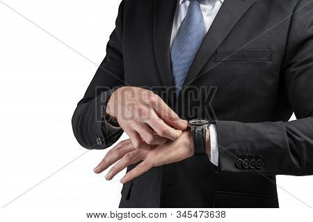 Close Up Of Businessman In Dark Suit Checking His Watch Isolated On White Background. Concept Of Pun