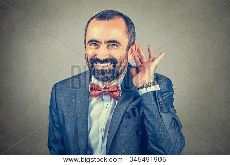 Man Eavesdropping Laughing Happy, Businessman With His Hand To His Ear Trying To Listen Smiling Look
