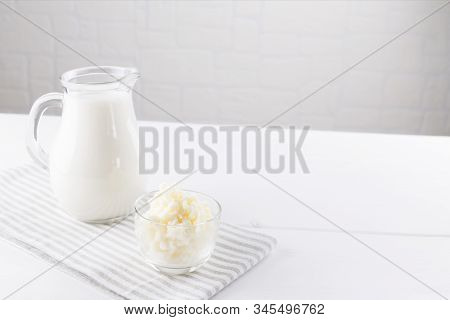 Homemade Fermented Beverage Kefir With Kefir Grains In Bowl On A White Background, Concept Of Natura