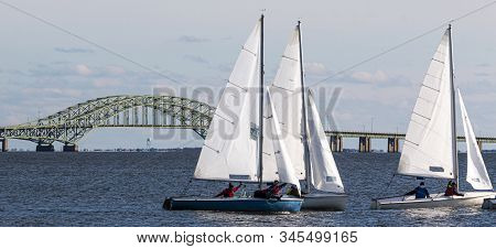 Three Small Saiboats Sailing In The Snowflake Regatta In The Great South Bay On A Cold December 2019