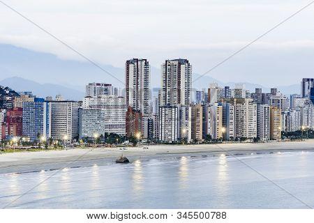 Coastal City At Dusk, When The Lights Of The City Begin To Turn On. Paulista Coast, Border Between S
