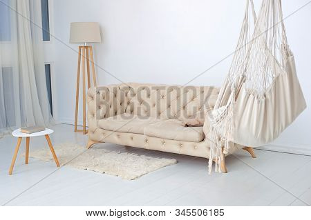 Living Room Interior With Hammock, Fluffy Rug And Coffee Table With  Lamp. Modern Hammock In Living