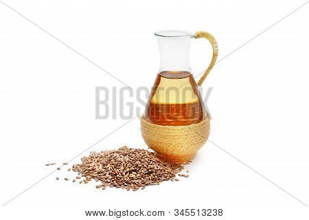 Flax Seeds And Oil Isolated On White Background.