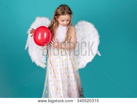 Kids Valentines Day. Face Of Beautiful Little Angel Girl On Color Background. Pretty Little Angel Gi