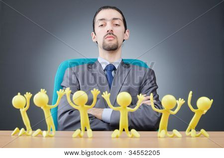 Boss with figures of his subordinates