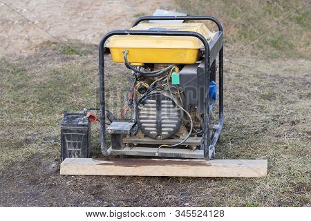 Close-up. Street Lighting. A Gasoline-powered Generator That Produces Current. Backup Or Emergency P