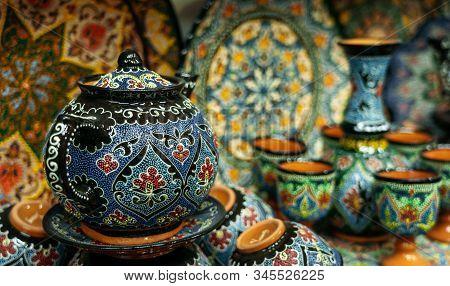 Ethnic Uzbek Ceramic Tableware. Decorative Ceramic Plates And Cups With Traditional Uzbekistan Ornam