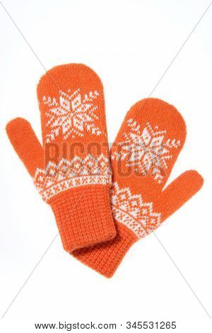 Warm Woolen Knitted Mittens Isolated On White Background. Orange Knitted Mittens With Pattern