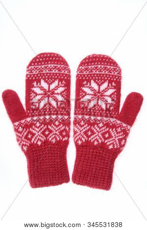 Warm Woolen Knitted Mittens Isolated On White Background. Red Knitted Mittens With Pattern
