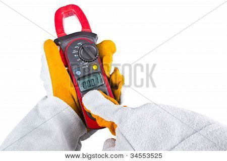 Gloves Acting With A Clamp Multimeter