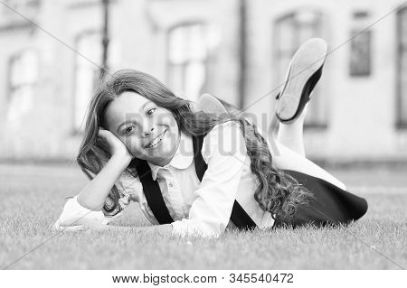 Getaway Day. Happy Schoolchild Relax On Green Grass. Small Girl Relax After School Outdoors. Relax A