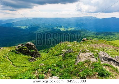 Mountain Landscape In Summer. View From The Top Of Carpathian Watershed Ridge In To The Distance. Bo