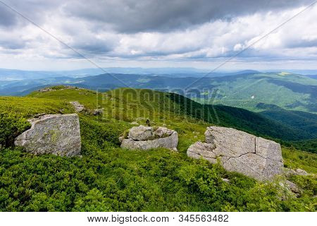 Beautiful Mountain Landscape In Summer. Rocks On The Grassy Alpine Meadows Rolling Into Distance. Cl