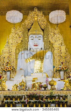 Buddah statue of the Kyauk Taw Gyi Phayar temple Mandalay city Myanmar (Burma)