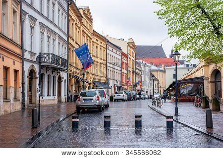 Krakow, Poland - Apr 30, 2019: France, Us, German And European Union Flags On Facades Of Consulate B