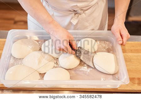 Dough For Neapolitan Pizza. Closeup Hand Of Chef Baker In Uniform White Apron Cook Pizza At Kitchen
