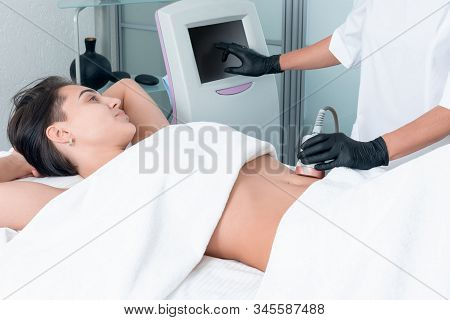 Ultrasound Cavitation Body Contouring Treatment. Woman Getting Anti-cellulite And Anti-fat Therapy O