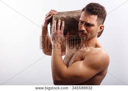 Athlete, Sportive, Brutal Man With Moustache, Naked Torso, Holding A Tree Trunk On His Shoulders, Ov